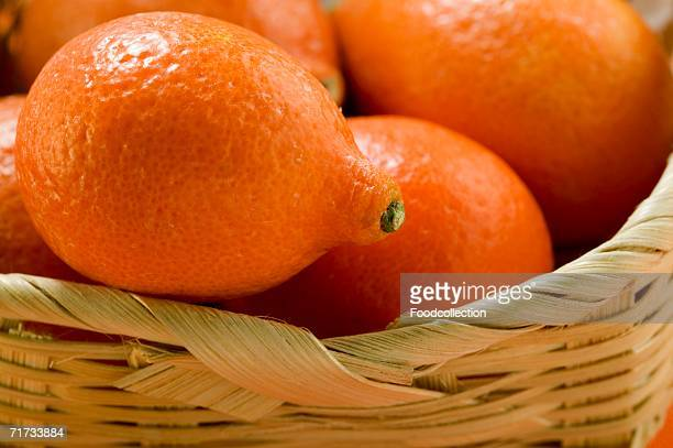 Small oranges in basket