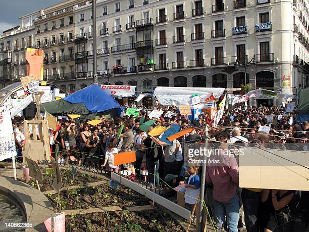 A small organic garden planted land taking advantage of the base of a monumental fountains of the square camp of the indignants on Puerta del Sol on...