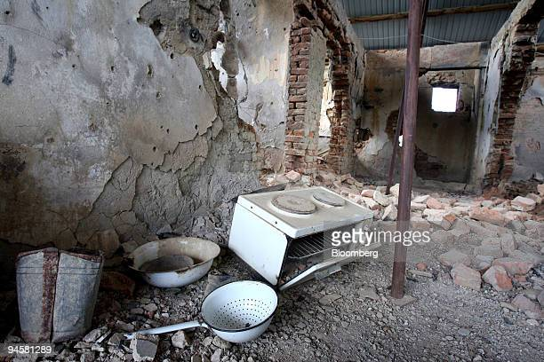 A small oven and kitchen materials lie on the ground in the destroyed home of the parents of Adem Jashari local commander of the Kosovo Liberation...