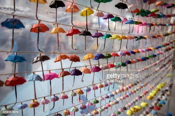 Small paper umbrellas symbols of the prodemocracy protests in Hong Kong are strung up in a display at the site of protest in the Causeway Bay area of...