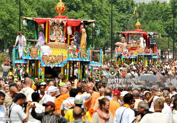 A small part of the large group of Hare Krishna devotees help to pull three giant decorative wheeled shrines from Hyde Park to Trafalgar Square to...