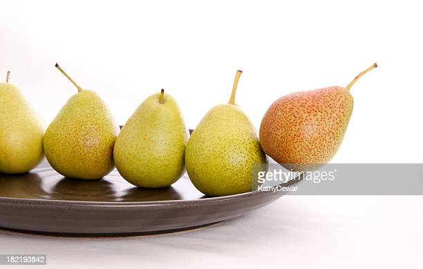 Small Pears Line Up on a Stoneware Plate