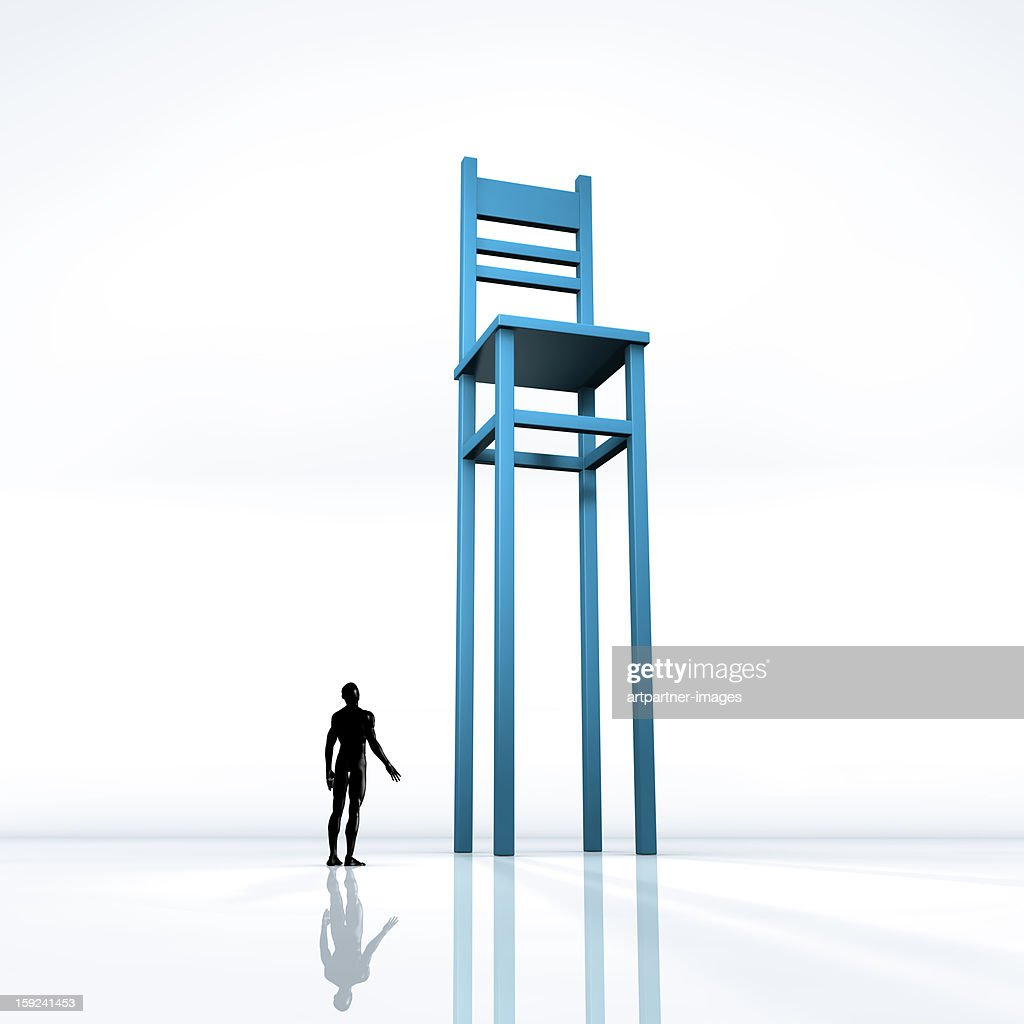 Small person looking up at a giant chair : Stock Photo