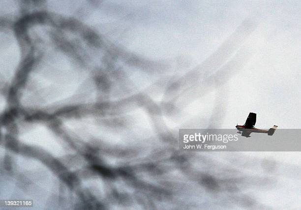 A small plane flies over Fairview Cemetery where the burial service for singer Whitney Houston will be held on February 19 2012 in Westfield New...