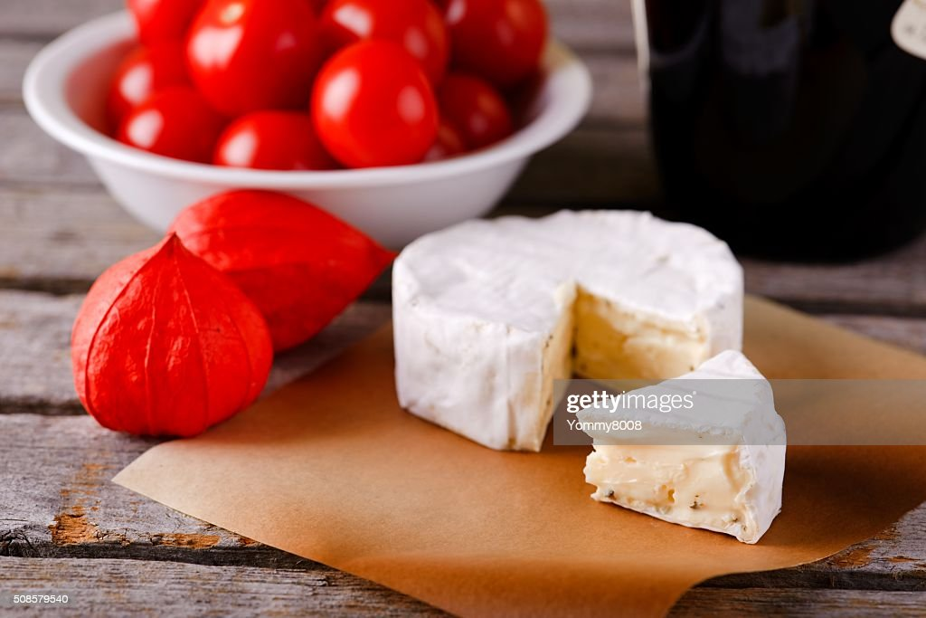 Small portion of camembert cheese in front of the rest : Stockfoto