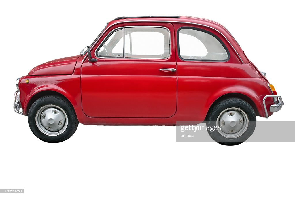 A small red old fashioned Fiat car on a white background
