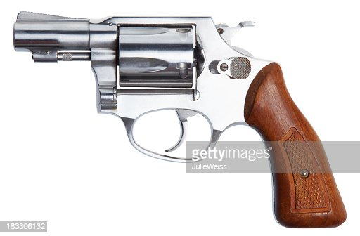 A small Revolver with a wooden handle