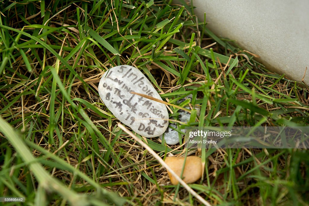 A small rock lies in front of a grave in Section 60, the burial ground for military personnel killed since 2001, at Arlington National Cemetery on May 30, 2016 in Arlington, Virginia.