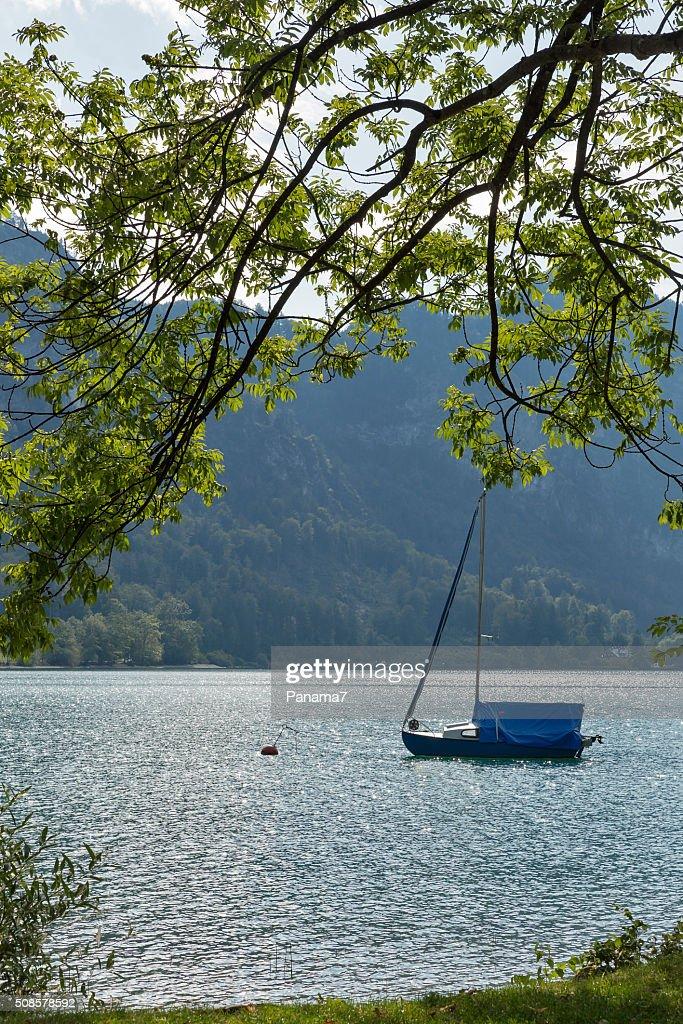 small sailing yacht on Alpine lake Mondsee, Austria : Stock Photo