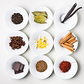Food Ingredients and Spices Organized on White Plates