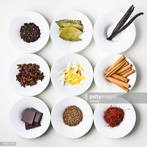 Small samples of world food items organized onto plates