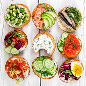 Small sandwiches on wooden rustic background, top view.
