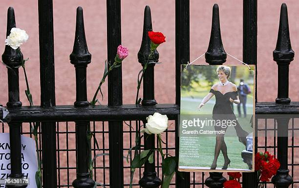 A small selection of flowers and tributes lie outside Buckingham Palace on the 10th anniversary of Diana Princess Of Wales and Dodi alFayed's death...