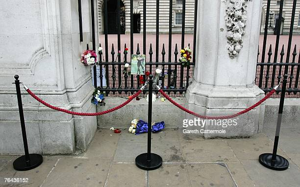 A small selection of flowers lie outside Buckingham Palace on the 10th anniversary of Diana Princess Of Wales and Dodi alFayed's death on August 31...