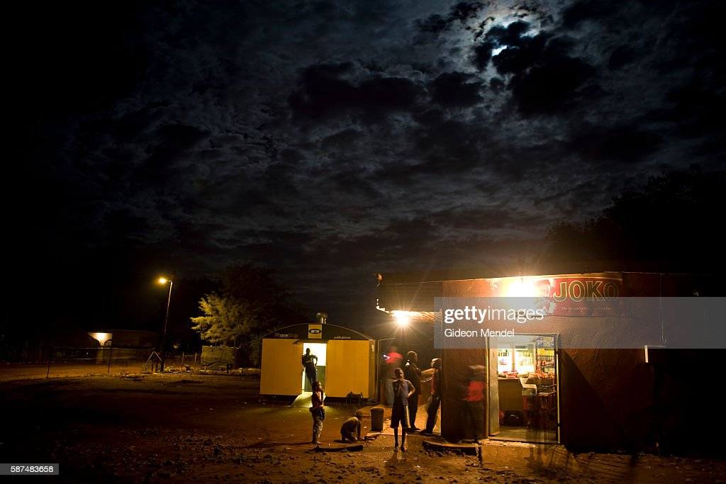 A small shop in the Makuleke Village stays open at night using electric lights under a dramatic African sky This might seem normal but the...