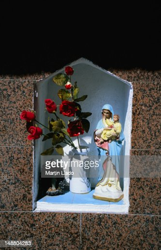 A small shrine set into the wall of a home in Giardini Naxos.