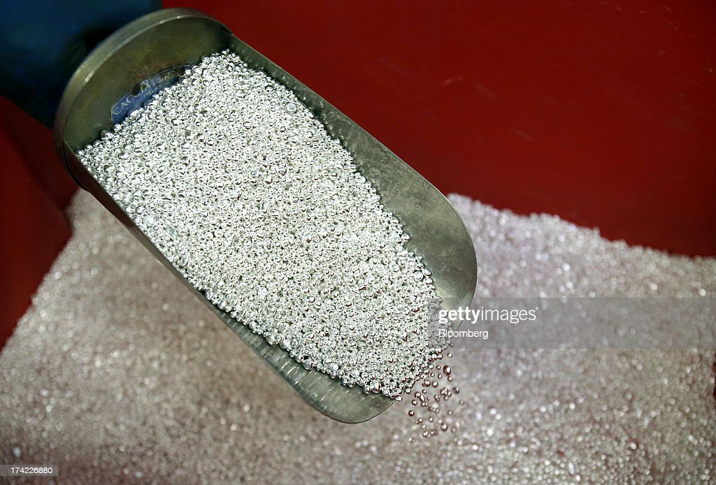 Small silver grains are scooped into a trowel during the refinery process at the Italpreziosi SpA precious metals plant in Arezzo, Italy, on Friday, July 19, 2013. Hedge funds raised bets on a gold rally before prices capped the biggest two-week gain in 20 months as Federal Reserve Chairman Ben S. Bernanke damped speculation that a cut in stimulus is imminent. Photographer: Alessia Pierdomenico/Bloomberg via Getty Images