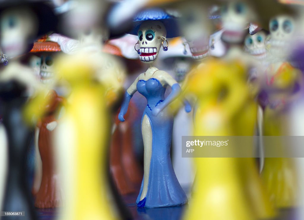 Small skeleton figures are displayed at the Jamaica market in Mexico City, on October 31, 2012, as Mexicans prepare to celebrate the traditional Day of the Dead. AFP PHOTO/ Pedro Pardo