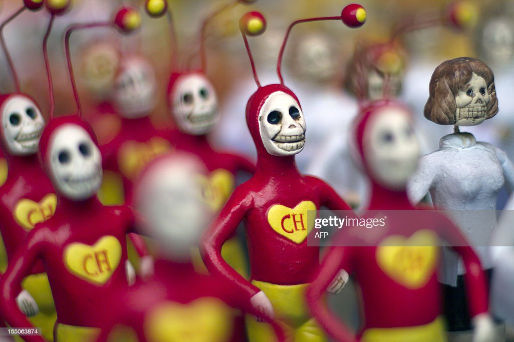 Small skeleton figures of Mexican TV series character 'El Chapulin Colorado' (The Red Grasshopper) are displayed at the Jamaica market in Mexico City, on October 31, 2012, as Mexicans prepare to celebrate the traditional Day of the Dead. AFP PHOTO/ Pedro Pardo