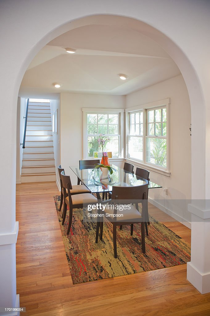 small, sparkling light-filled dining room : Stock Photo