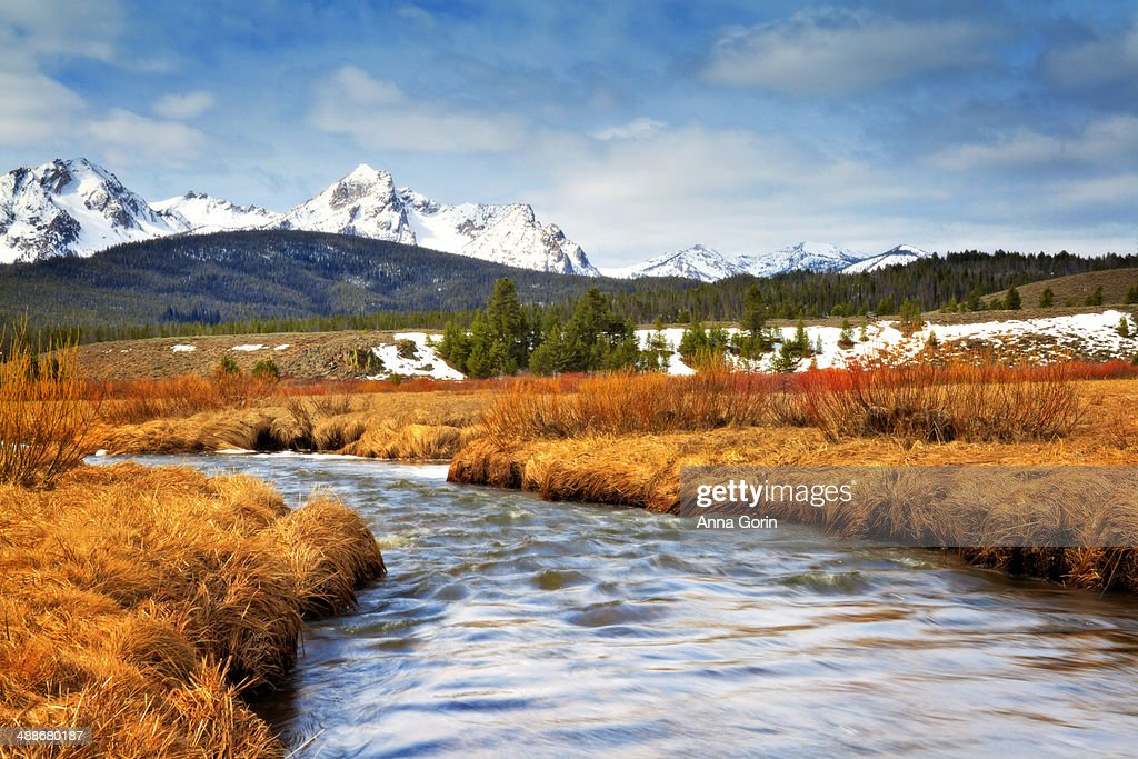 Small stream and Sawtooth Mountains in Stanley, ID
