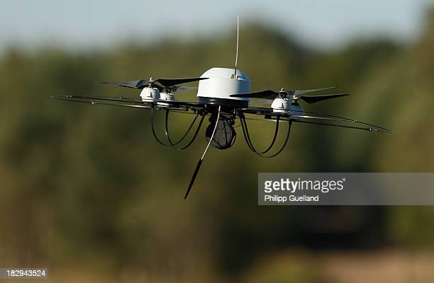 A small surveillance drone flies during the annual military exercises held for the media at the Bergen military training grounds on October 2 2013...