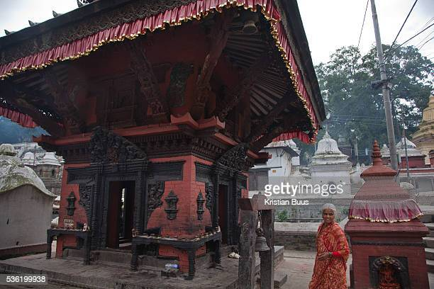 A small temple forming a part of the Pashupatinath Temple complex with Kama Sutra wood carvings