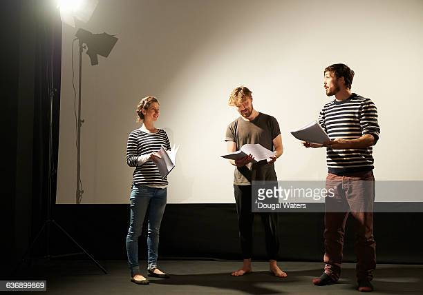 Small theatre group rehearse on stage.