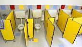 small toilet with yellow doors in the kindergarten