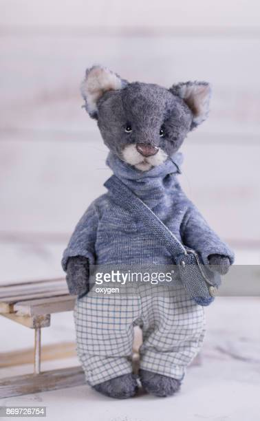 Small Toy Gray Cat in blue Sweater
