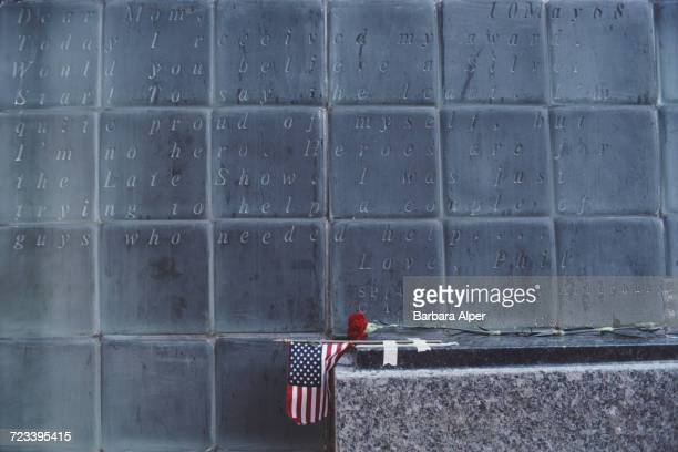 A small US flag and a red rose left at the Vietnam Veterans Plaza shortly after its dedication Manhattan New York City May 1985