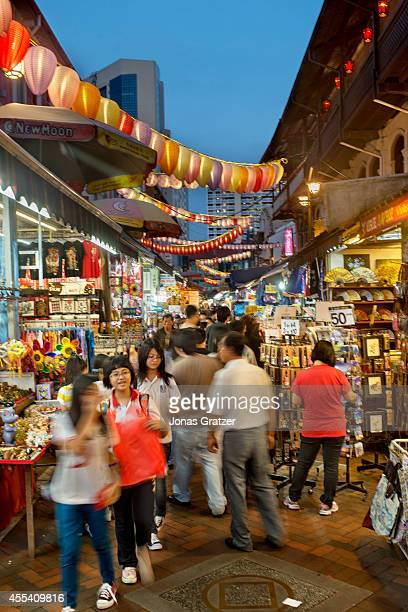 A small walking street housing many souvenir and gift shops during the overcrowded hours of the night