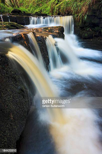 Small waterfalls in autumnall woods.