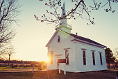 The warm setting sun glows from behind a quaint church in rural Nova Scotia.
