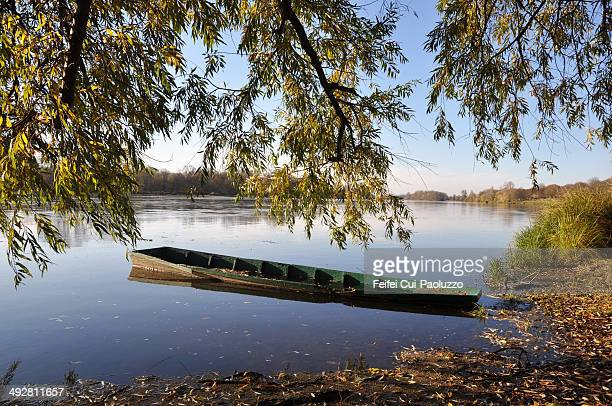 A small wooden boat at river side of Briare, in the Loiret department, France