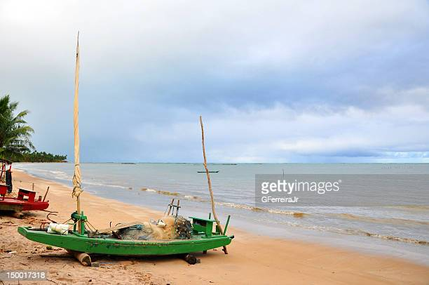 Small wooden boat on beach