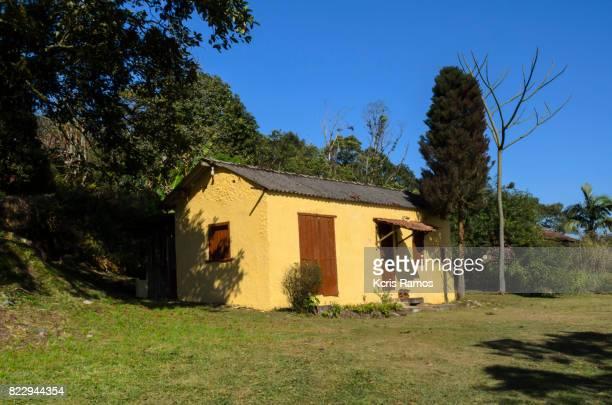Small yellow masonry house