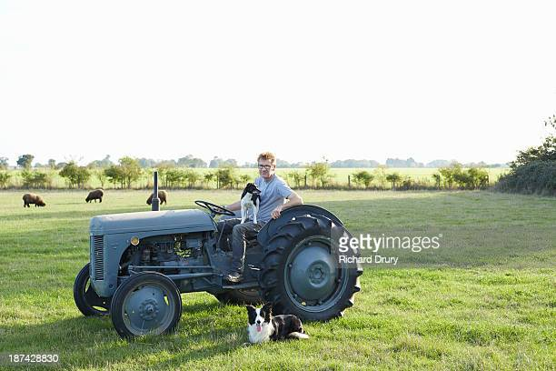 Smallholder on his farm with his dogs