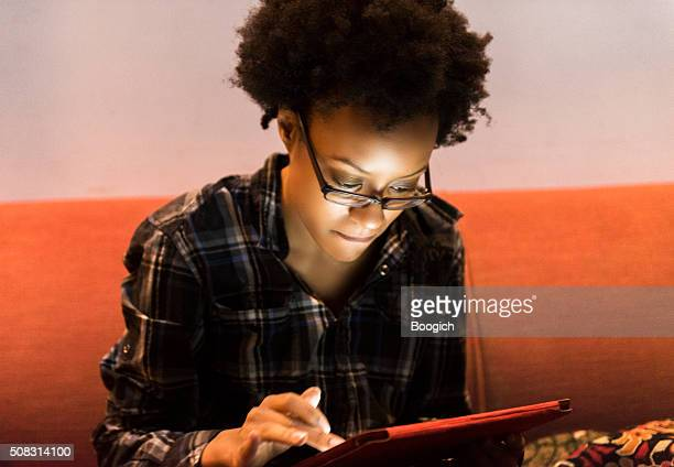 Smart Black American Woman Browsing Internet on Tablet Brooklyn NYC