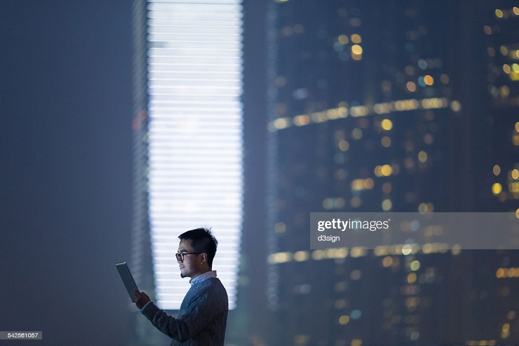 Smart businessman using digital tablet in city : Stock Photo