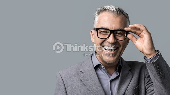 Smart businessman with glasses posing : Stock Photo