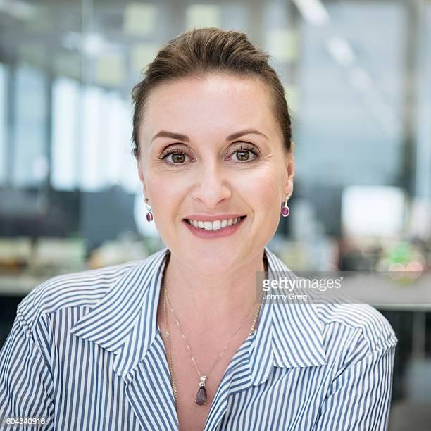 Smart businesswoman smiling towards camera, portrait