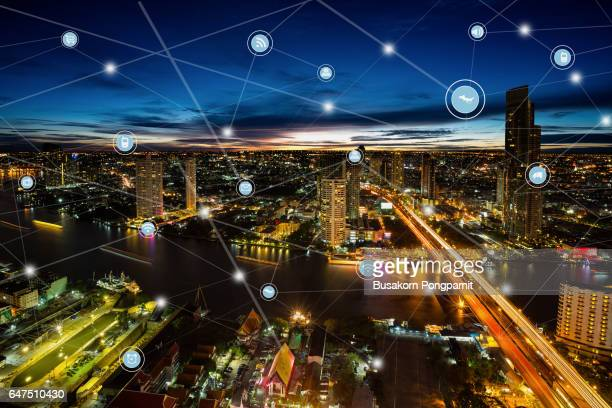 Smart city and wireless communication network, business district with office building, abstract image visual, internet of things