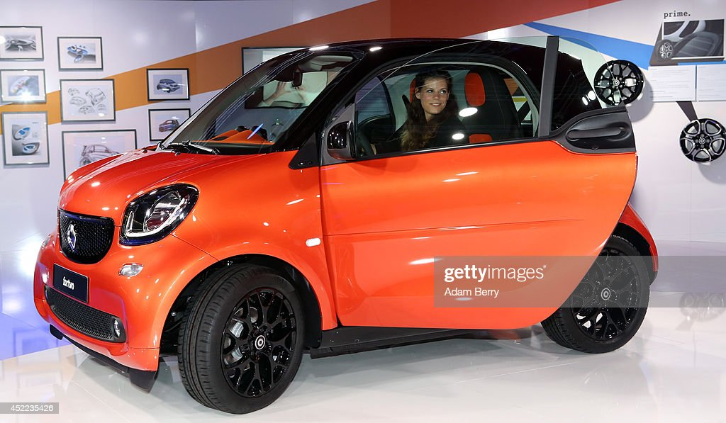 a smart fortwo car sits on display at the presentation of the latest models of daimlers