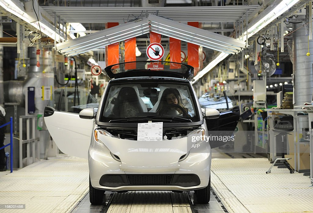 A Smart ForTwo is pictured at the Smart car factory of Hambach, eastern France, on December 11, 2012. The third-generation Smart electric drive is scheduled to be launched in the U.S. and Europe by the second quarter of 2013 and Smart plans to mass produce the electric car with availability in 30 markets worldwide. VERHAEGEN