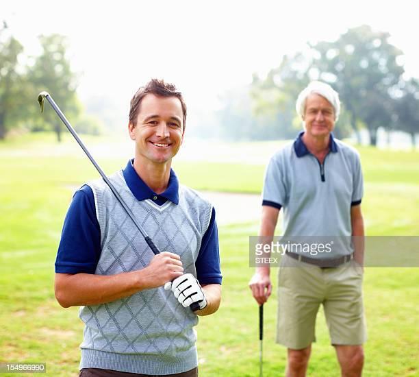 Smart golfer smiling