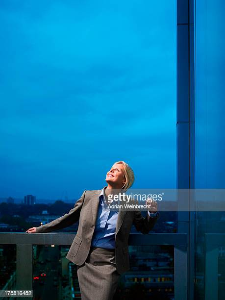 Smart lady in corporate environment overlooking the city