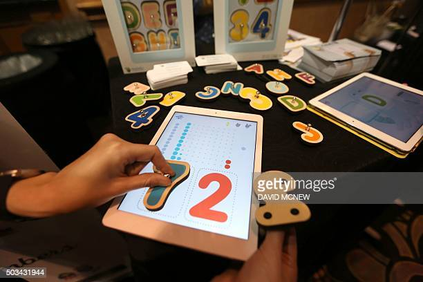 Smart Letters interactive wooden letters are used with a Marbotic app on a tablet for learning skills at The CES Unveiled press event January 4 2016...