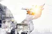 Smart logistic , Augmented reality technology , internet of things , industry 4.0, disruption and supply chain concept. Double exposure of man using mobile phone with airplane ,drone,truck,Cargo ship.