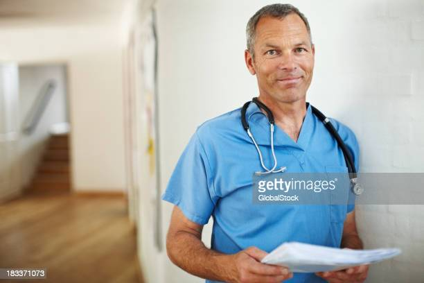 Smart male doctor in uniform at a hospital corridor